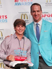 Peyton Manning poses with Male Golfer of the Year Hayden White (Benton) at the Shreveport Times Sports Awards at the Shreveport Convention Center in Shreveport, Monday, May 15, 2017.