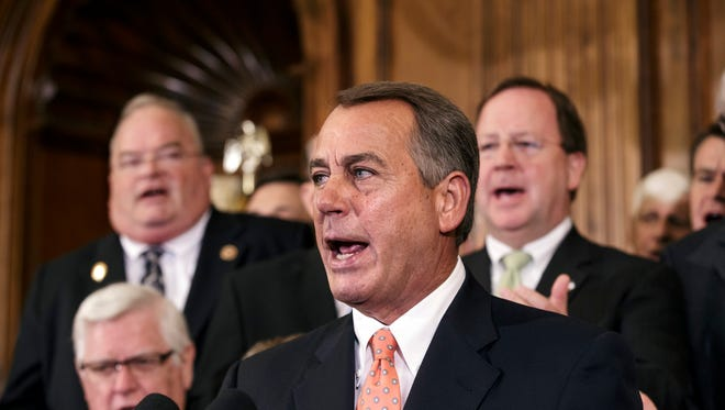 House Speaker John Boehner and fellow House Republicans on Friday after passing the budget bill that would defund ObamaCare.