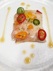 Hamachi crudo with melon gazpacho at Sails Restaurant,