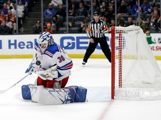 New York Rangers goaltender Henrik Lundqvist stops a shot during the second period of an NHL hockey game against the Anaheim Ducks Saturday, Dec. 14, 2019, in Anaheim, Calif. (AP Photo/Marcio Jose Sanchez)