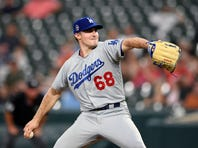 FILE - In this Wednesday, Sept. 11, 2019 file photo, Los Angeles Dodgers starting pitcher Ross Stripling delivers a pitch during a baseball game against the Baltimore Orioles in Baltimore. Stripling along with ten major leaguers won't be getting their twice-a-month paychecks during the abbreviated 60-game season. That's because the $286,500 in advance salary they received after opening day was postponed because of the coronavirus pandemic is more than what they are owed from their prorated salaries.  (AP Photo/Nick Wass, File)