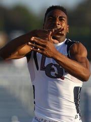 La Quinta High School senior Koty Burton celebrates his win in the 300-meter hurdles at Master's Meet at Cerritos College Stadium on May 27, 2016.