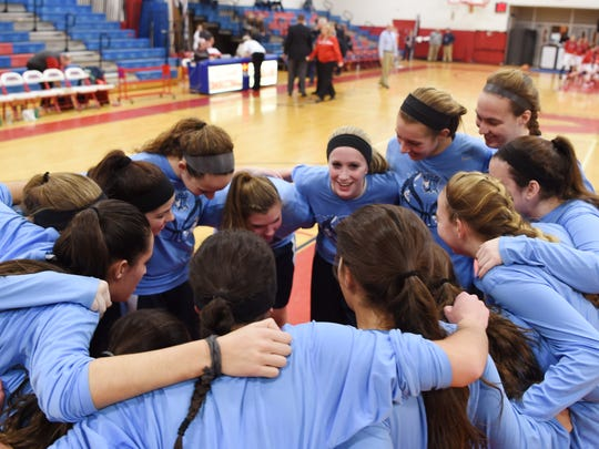 John Jay's girls basketball team huddles before the start of Tuesday's game versus Roy C. Ketcham in Wappingers Falls.