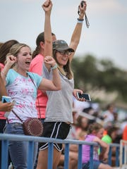 Fans cheer on their athletes during the Region II-1A Track Meet Saturday, April 28, 2018, at Angelo State.