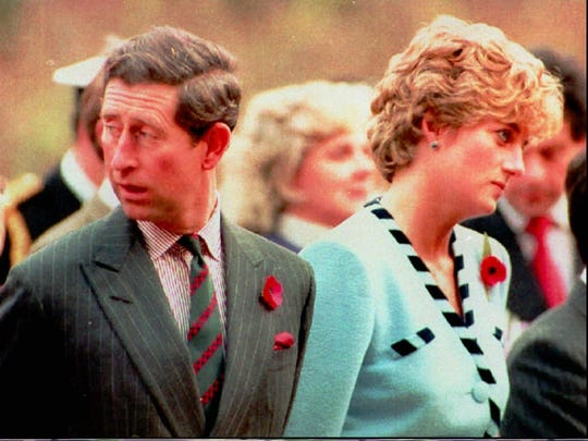Britain's Prince Charles and Princess Diana of Wales look their separate ways during a memorial service on their tour of South Korea on Nov. 3, 1992.