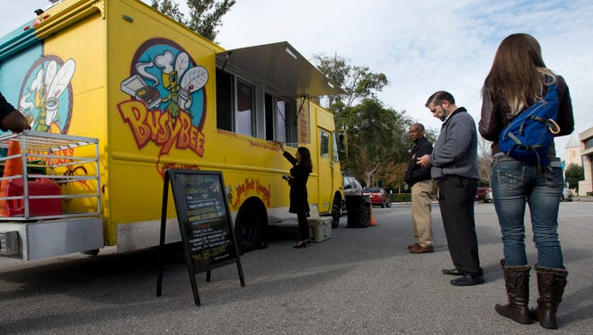 Food trucks begin operations in the parking lot of city hall Thursday Jan.7, 2015. Under a new mayoral decree, food truck operations are now allowed on city hall property Thursday through Saturday from 8am-8p.m.