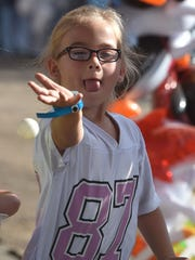 Addison Paye of Brussels tries her luck winning a goldfish at the Door County Fair.