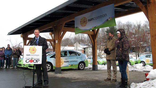 Vermont Republican Gov. Phil Scott stands in front of a new solar power project he helped inaugurate on Monday, Jan. 9, 2017 in Montpelier, Vt. Scott, who took office last week, said he remains committed to the goal set by his predecessor of getting 90 percent of the state's power from renewable sources by 2050. (AP Photo/Wilson Ring)