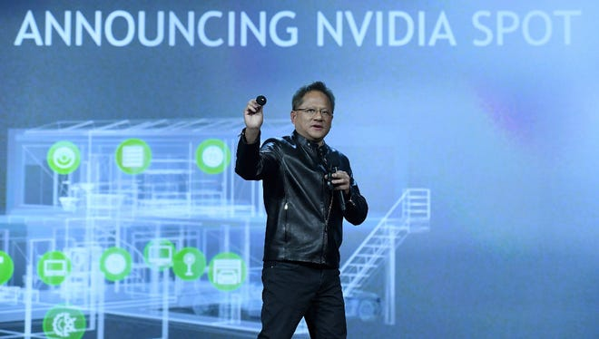 Nvidia Founder, President and CEO Jen-Hsun Huang introduces the Nvidia Spot, a USD 49.95 microphone and speaker that will let owners use Google Assistant anywhere in a home, as he delivers a keynote address at CES 2017