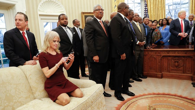 President Donald Trump, right, meets with leaders of Historically Black Colleges and Universities (HBCU) in the Oval Office on Feb. 27. Also at the meeting was Kellyanne Conway, counselor to the president, on the couch.