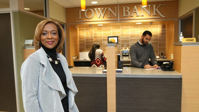 Town Bank's new branch at 4732 W. Lisbon Ave. in Milwaukee is led by LaVerne Davis, vice president and district branch manager. Working behind the counter are universal bankers Cherry McKnight (left) and Luis Fernandez.
