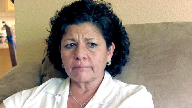 FILE - In this July 14, 2015 file photo from video, Tina Cordova talks of her late father, Anastacio Cordova, in her Albuquerque home. Cordova believes her father, who died in 2013 after suffering from multiple bouts of cancer, was affected by the atomic bomb Trinity Test in New Mexico since he lived in nearby Tularosa, N.M. as a child. Residents of a New Mexico Hispanic village near the site of the world's first atomic bomb test want to share their stories with Congress this summer. The Tularosa Basin Downwinders Consortium is raising money so its members can travel to Washington, D.C., and testify about the effects of the Trinity Test on generations of Tularosa residents.