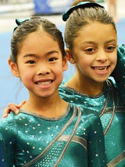 Jasmine Chen, left, and Mia Cinque from Paramount Gymnastics