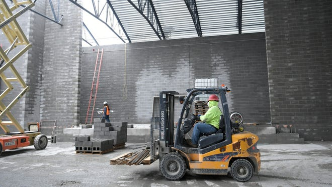 Construction crews work on the auditorium at the new Jordan Elementary, a new school on Split Log Road in Brentwood.