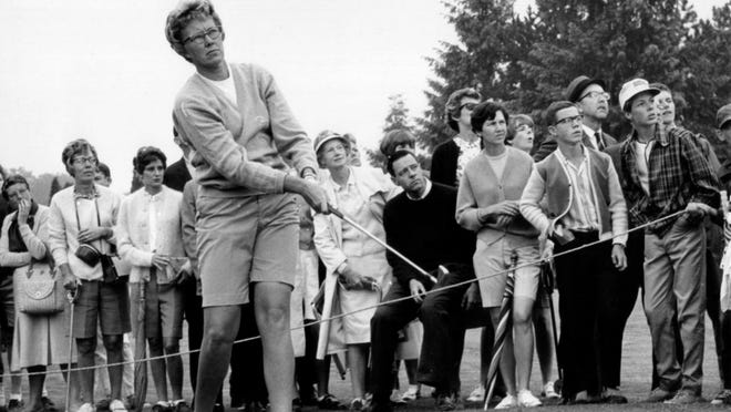 In this  1967 file photo, the gallery follows Mickey Wright's iron shot from the fairway at the Toronto Golf Club. Hall of Fame golfer Wright, who won 82 LPGA tournaments including 13 majors, died Monday, Feb. 17, 2020, of a heart attack, her attorney said. Wright was 85.