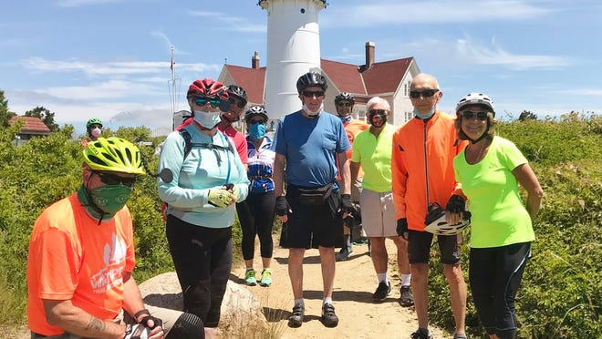 Senior cyclists stop by Nobska Light in Woods Hole to enjoy the views. Left to right: Rich Carnes of Middleboro, Claire Bray of Brockton, Dan Egan of Plymouth, Debra Gabriele of Raynham, Rich Quindley of Hanson, John Goldrosen of Whitman, Ed Fopiano of Middleboro, Al Meserve of Raynham, Camille Barudin of No. Dartmouth.