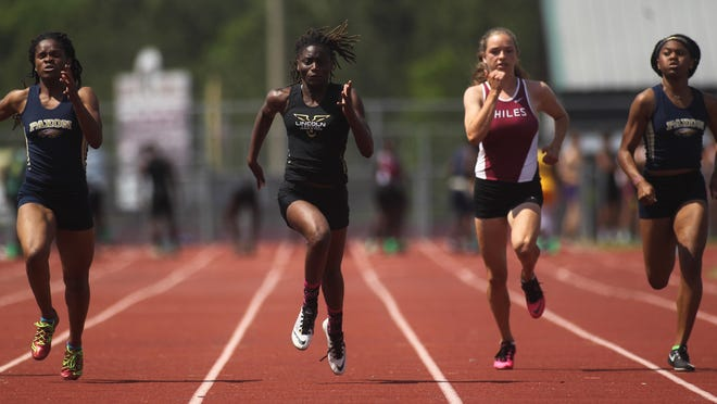 Lincoln junior Jacquevia Jones sprints to a win in the 100-meter dash during Tuesday's District 3-3A meet at Chiles. Jones' district title aided the Trojans' district championship.