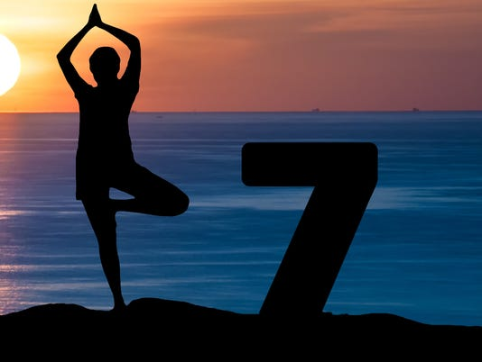 Silhouette woman play Yoga on sea Happy New Year 2017