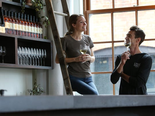 Colleen and Sebastian Hardy in their tasting room at