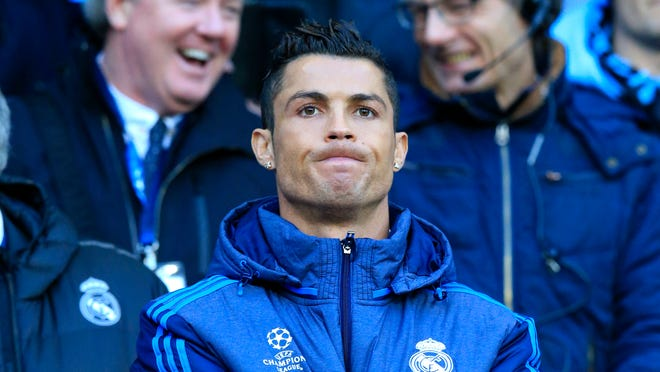Real Madrid's Cristiano Ronaldo watches the math at the bench during the Champions League semifinal soccer match between Manchester City and Real Madrid, at the City of Manchester stadium in Manchester, England, Tuesday, April 26, 2016. (AP Photo/Jon Super)