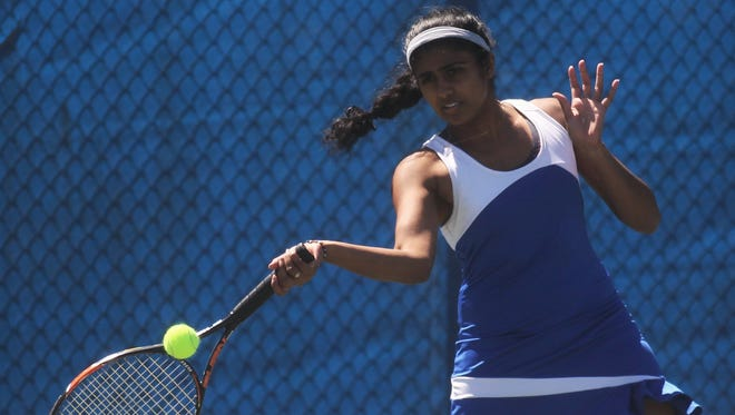 Rickards senior Charitha Moparthy plays during the District 2-2A tennis tournament at Tom Brown Park. Moparthy won a district title to remain undefeated in district play the last three years.