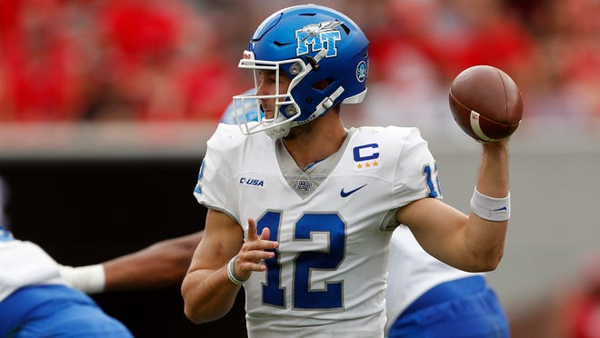 Middle Tennessee quarterback Brent Stockstill (12) looks for an open receiver in the first half of an NCAA college football game against Georgia, Saturday, Sept. 15, 2018, in Athens, Ga. (AP Photo/John Bazemore)