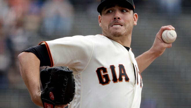 FILE - In this Sept. 20, 2017 file photo, San Francisco Giants starting pitcher Matt Moore throws to the Colorado Rockies during a baseball game in San Francisco. As planned, San Francisco exercised their $7 million option for Moore. In 2017 He was 6-15, a career-high losses, with a 5.52 ERA over 174 1/3 innings. He allowed a career-high 107 earned runs. (AP Photo/Marcio Jose Sanchez, File)