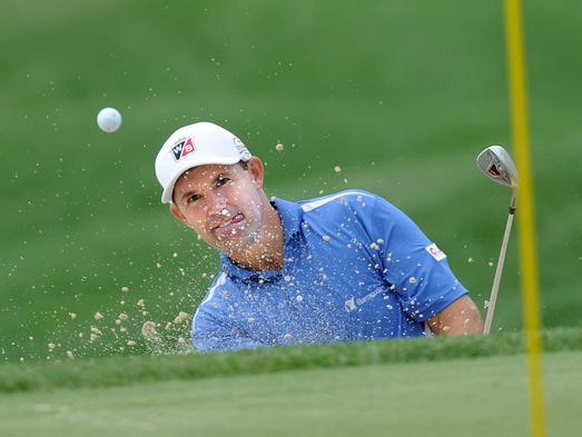 Padraig Harrington blasts out of a bunker during the first round of the 2014 PGA Championship golf tournament at Valhalla Golf Club in Louisville.