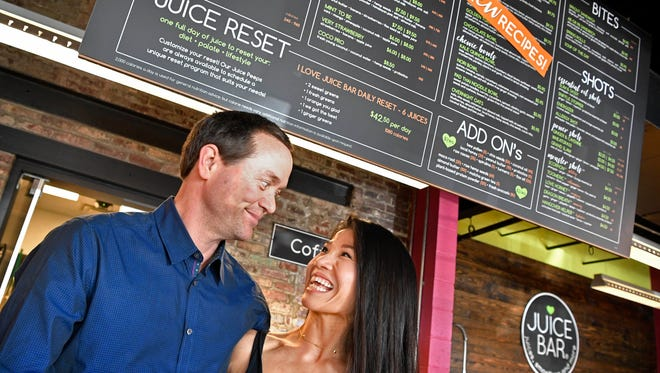 John and VUI Hunt, owners of I Love Juice Bar have 45 locations and must comply with a new law that states restaurants with 20 or more locations have to add calorie counts to menus by May 7 under a federal law about to take effect following years of delays. 