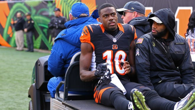 Cincinnati Bengals wide receiver A.J. Green (18) is carted off the field after being injured in the first half against the Buffalo Bills at Paul Brown Stadium.