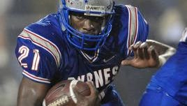 Marcus Lattimore (21) follows a block in this 2008 game between Byrnes and Spartanburg High.