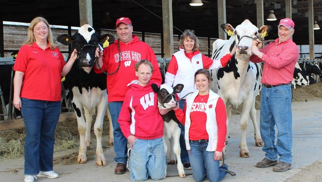 Kellercrest Registered Holsteins, Inc. of Mount Horeb, WI, were honored with Outstanding Achievement in Resource Stewardship. The family include Kareen and Mark Keller (far left) are joined by brother Tim and his wife, Sandy Keller and their children Andrew and Kim (front).