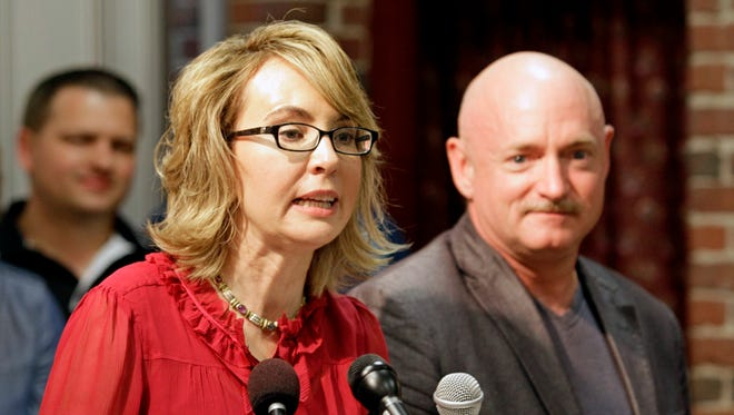 Former Arizona Rep. Gabrielle Giffords, accompanied by her husband, retired astronaut Mark Kelly, is pushing to reduce gun violence.