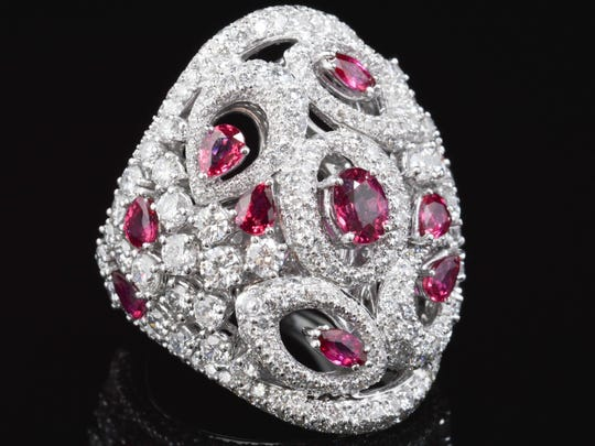 An 18-karat white gold ruby and diamond cocktail ring