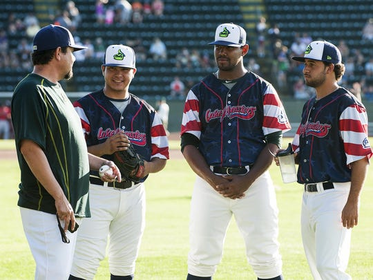 Vermont pitching coach Carlos Chavez (left) talks to a few pitchers before the start of the game between the Williamsport Crosscutters and the Lake Monsters at Centennial Field on Thursday night in Burlington.