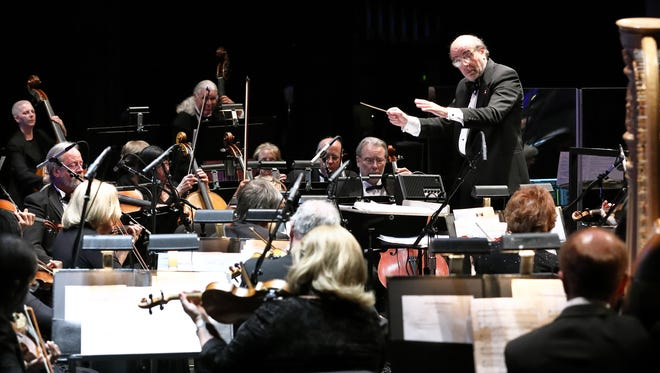 (left to right): Gary Berkson, music director of The Desert Symphony, conducting the orchestra during the gala concert.