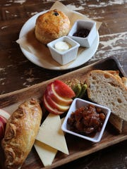 The Ploughman's Lunch: sharp cheddar, multigrain bread, cornichons with mustard and seasonal fruit, and a savory Dingle Pie, an Irish-style lamb pie with a flaky crust at The Village Tearoom Restaurant and Bake Shop in New Paltz, Feb. 8, 2017. Also pictured is a scone with clotted cream and raspberry jam.