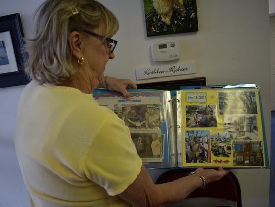 Sebastian Art Club historian Carol H. Bennett displays