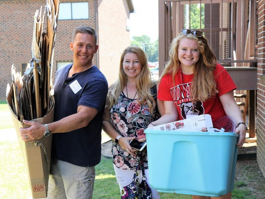 Marc Ciato and Jenny Ciato assist their daughter Ashley move in Friday at Union University.
