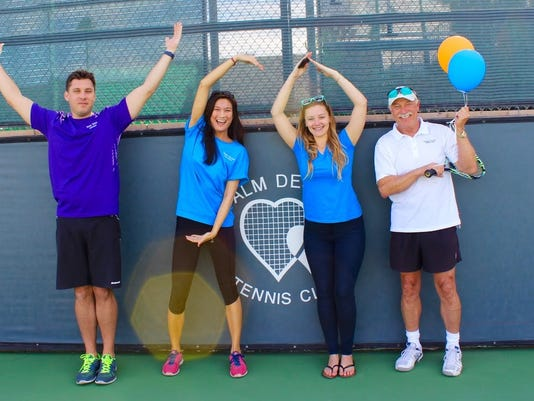 635889219243390126-Board-Member-Ryan-Manos-with-Co-Founders-Katarina-Reveche-and-Brittnea-Reich-spelling-out-YSA-with-tournament-winner-Jake-McDougal.jpg
