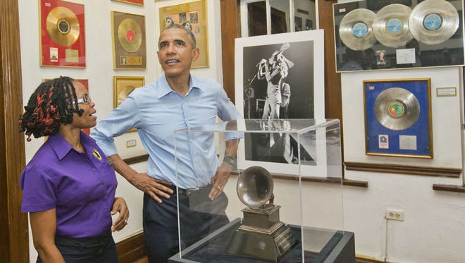 President Obama visits the Bob Marley Museum with tour guide Natasha Clark, Wednesday in Kingston, Jamaica.