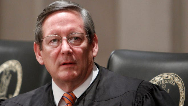 Virginia Supreme Court Justice, Donald W. Lemons in the court chambers in Richmond, Va., Friday, Oct. 21, 2011. (AP Photo/Steve Helber)
