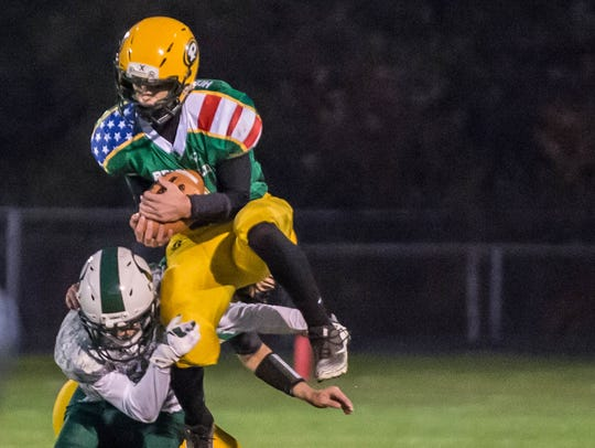Pennfield's Jacob Herpin makes an interception during