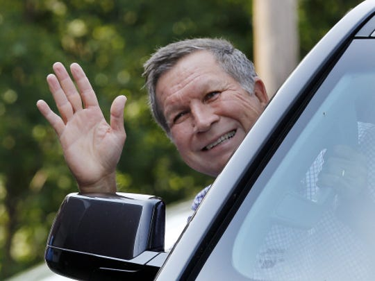Republican presidential candidate Gov. John Kasich, R-Ohio, waves as he arrives for a campaign stop at Robie's Country Store Wednesday, Sept. 2, 2015, in Hooksett, N.H.