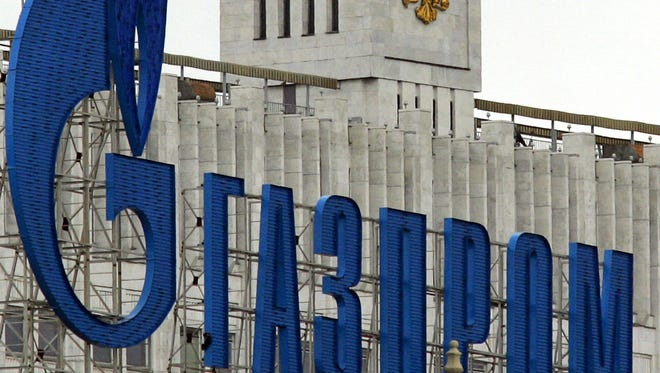 The logo of Russian state-controlled natural gas giant Gazprom is shown in front of Russia's Government headquarters in Moscow on July 1, 2006. Gazprom warned Ukraine on February 7, 2014,  that it could cut off gas exports if the new authorities in Kiev did not pay a bill for debt that now stands at $1.89 billion.