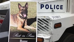 Police vehicle with a picture of Bane the fallen K-9