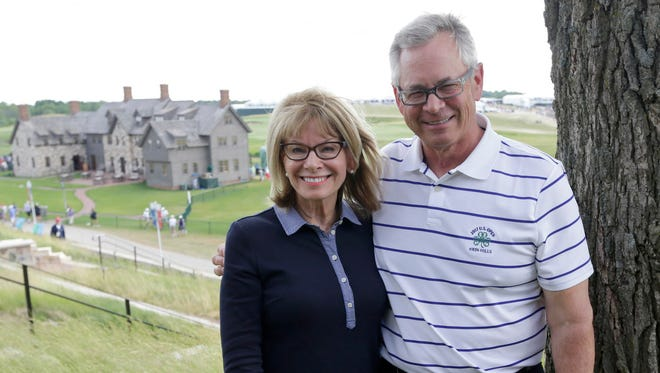 "Patti Loftin and her brother Bill Jacobs attend the final round of the U.S. Open at Erin Hills on Sunday. Their father, Marshall ""Chick"" Jacobs, passed away Friday during the second round at the golf course. Their mother, Lucille Jacobs, died Tuesday."