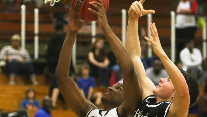 Asheville High senior Trey Irby, left, leads the Cougars in scoring and rebounding.