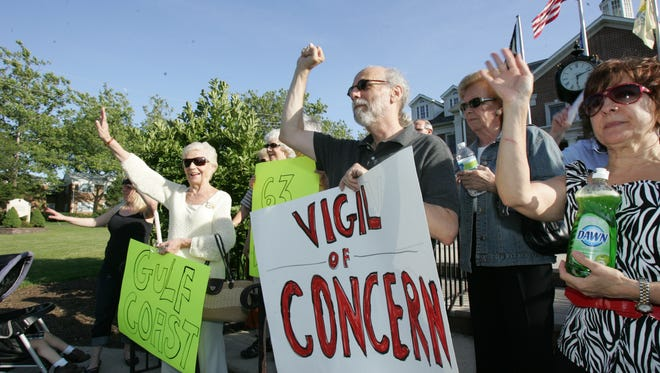 Little Falls activist Arnold Korotkin, at center with sunglasses and sign, during a rally in Little Falls in 2010.