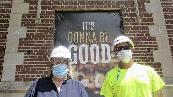 Katharine Moore, executive director of the Jefferson Avenue Center, and Denver Boling, superintendent of Lehman Daman Construction Services, stand in front of the Good Haus, 966 S. High St. in the Brewery District. The Good Haus, which takes over the former Maennerchor building, will be a new hub for nonprofits operating under the auspices of the Jefferson Avenue Center. The building's renovation is scheduled for completion Sept. 15 and is set to welcome tenants Oct. 1. Lehman Daman is the general contractor.
